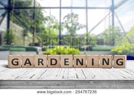 Gardening Sign In A Green House On A Wooden Table In Bright Light In The Springtime