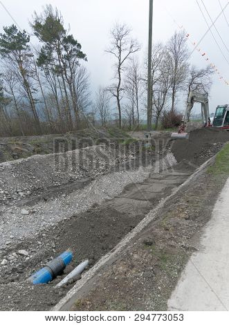 Laying Large Industrial Water Pipes In An Earth And Dirt Ditch For Water Supply And Irrigation With