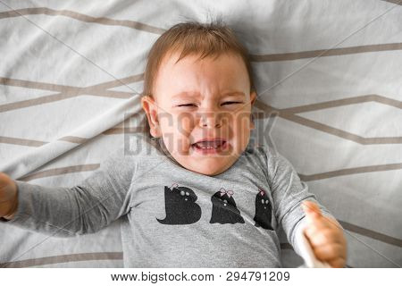 One Year Old Baby Crying In Bed