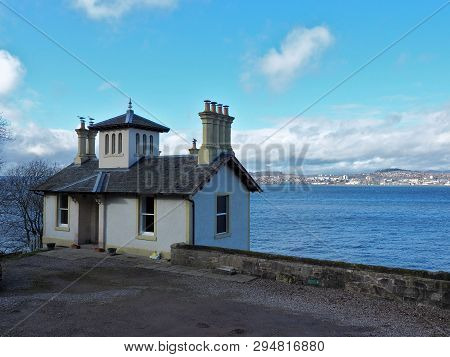House, Tay River And City.  Dundee, Scotland - February 20, 2019 A Residential House On The River Ta