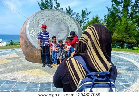 Kudat,sabah-feb 3,2018:back View Of Muslim Woman Taking Travel Photo By Smartphone Of The People In