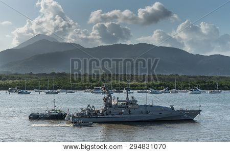 Cairns, Australia - February 18, 2019: Wollongong Australian Navy Vessels Sails Up The  Creek Into T