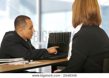 Business Man Showing Laptop To His Partner