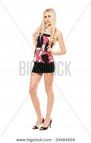Pretty Leggy Young Blonde In Black Miniskirt