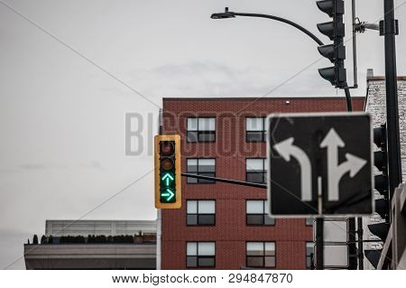Traffic Light Abiding By American Standards Indicating Two Directions With Green Light, At A Crossro