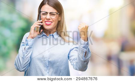 Young beautiful business woman speaking calling using smartphone over isolated background annoyed and frustrated shouting with anger, crazy and yelling with raised hand, anger concept
