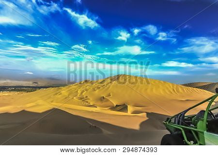 The Sand Dune Desert Near The Oasis Of Huacachina, Peru. A Tourist Adventure For Dune Buggy And Sand
