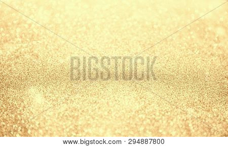 Abstract Bokeh Background. Christmas Glittering Background. Abstract Christmas Golden Background. Gl