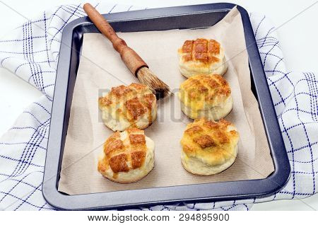 Hungarian Traditional Cheese Pogacsa With Paper On A Baking Tray