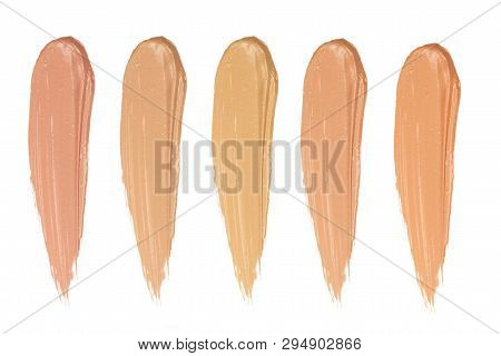 Shades Of Foundation On White Background. Closeup Of Different Tones Of Liquid Foundation.cosmetic S