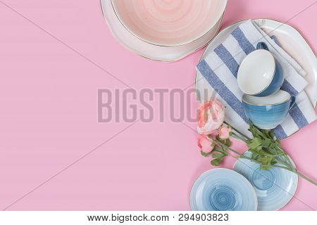 Empty Plates And Bowls On Pink Background. Top View With Copy Space