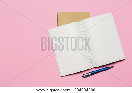 School Notebook On A Pink Background, Notepad On A Table.top View