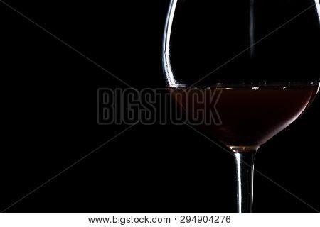 Elegant Glass Of Wine On A Black Background