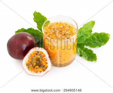 Fresh Passion Fruit Juice In Glass With Green Leaf Isolated On White Background, Fruit Healthy Conce