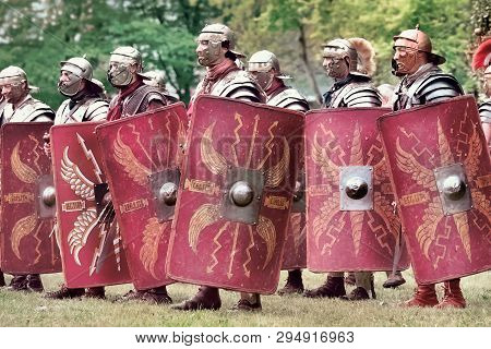 Gessate, Milan, Italy: April 07, 2019: Reenactment Of Ancient Roman Legionary Soldiers During Battle