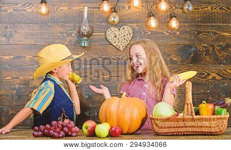 poster of Held responsible for daily farm chores. Kids farmers girl boy vegetables harvest. Family farm. Children presenting farm harvest wooden background. Reasons why every child should experience farming