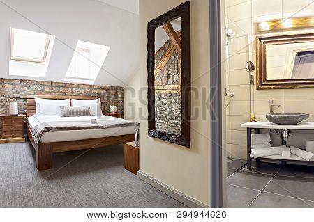 Bedroom Interior In Luxury Loft, Attic, Apartment With Roof Windows And Bathroom - Hotel Room - Vaca