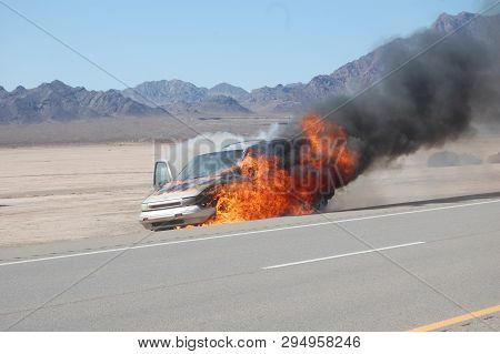 Highway I. 95 Searchlight, Nevada - Circa August 26th 2009 -car Bursts Into Flames On The Strip Of D
