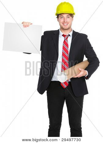 Engineer / architect man showing blank sign holding plans and wearing yellow construction work protective helmet. Young happy smiling caucasian male professional isolated on white background.
