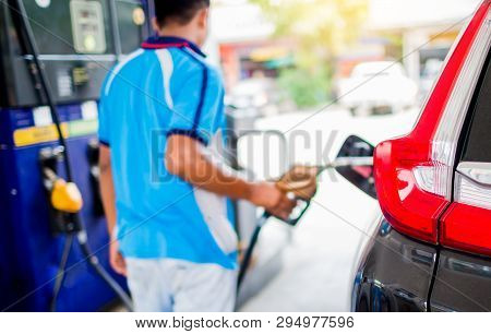 Blurry Hands Refilling The Car With Fuel And Press Control Panel At The Gas  Station, Black Car In G