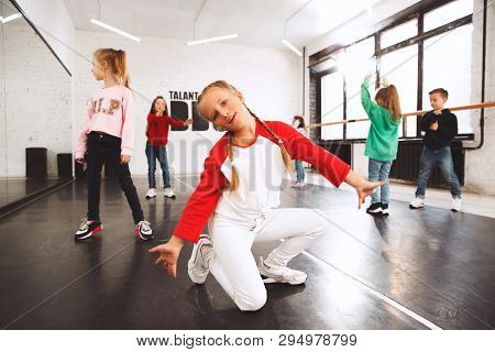 The Kids At Dance School. Ballet, Hiphop, Street, Funky And Modern Dancers Over Studio Background. C