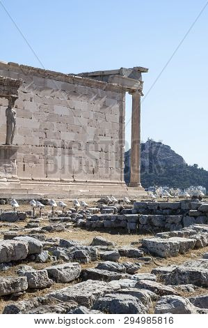 ATHENS, GREECE - 06/23/2013 - panoramic background with Acropolis, porch of caryatids, Erechtheum Temple in Athens, Greece poster