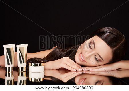 Beautiful Girl On Black Glass With Creams