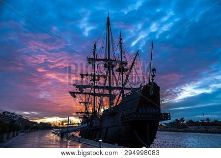 Galleon In The Port Of Valencia In A Fantastic Sunrise