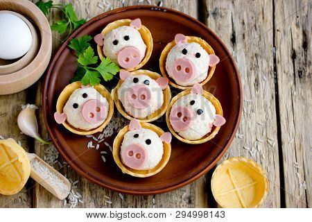 Stuffed Snack Tartlets With Rice, Crab Sticks, Egg, Garlic In The Form Of Funny Pigs
