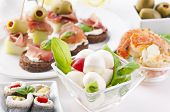 spanish tapas with caprese, canapes and seafood poster