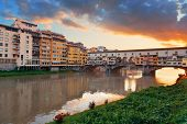 Ponte Vecchio over Arno River in Florence Italy at sunrise poster