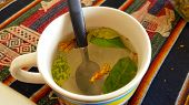 A cup of Coca tea or Mate de Coca in Bolivia. Mate de Coca is an herbal tea (infusion) made using the raw or dried leaves of the coca plant. poster