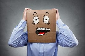 Businessman with cardboard box on his head showing a shocked and surprised expression expression concept for failure, surprise, fear, anxiety or disbelief
