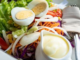 Fresh Vegetable Salad With Sliced Boiled Eggs, Tomato And Lettuce With Mayonnaise Sauce