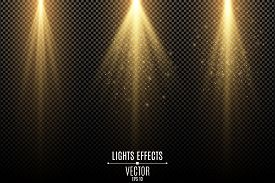 Set Of Golden Lights Effects Isolated On A Dark Transparent Background. Golden Rays With Flying Magi