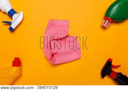 Means For Cleaning The House On A Yellow Background. Center Rag,