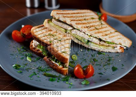 Toasted Shredded Chicken Breast And Salad Sandwich Served On A Rustic Wooden Table Wrapped In A Brow