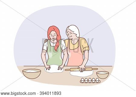 Happy Family Cooking Together Concept. Happy Elderly Grandmother Hugging Granddaughter And Showing H