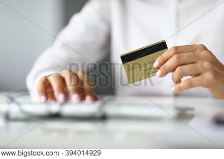 Silhouettes Of Woman In Whose Hands Credit Bank Card. Lending To Individuals And Legal Entities Conc