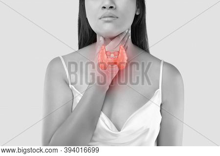 Women Thyroid Gland Control. Sore Throat Of A People On Gray Background