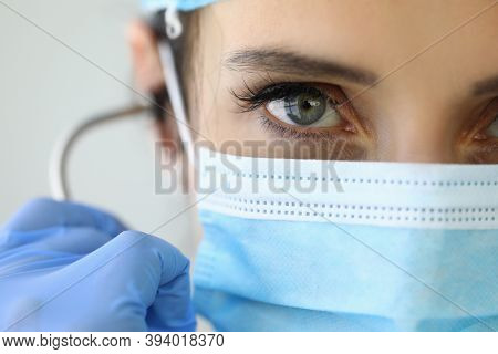 Confident Look Doctor In Protective Medical Mask. Coronavirus Pandemic And Doctors Fight For Patient