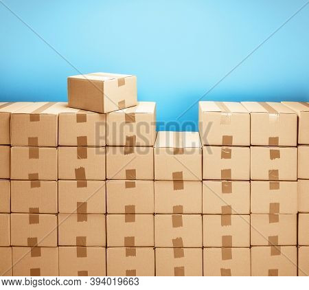Cardboard Boxes For Delivery Or Moving. Stack Of Boxes And Blue Background