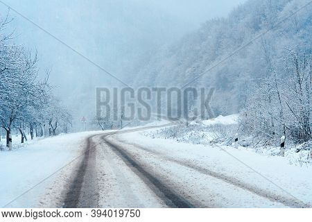 Country Road Through Mountains In Winter. Beautiful Nature Scenery. Snow Weather