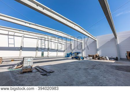 Warehouse construction site. Building a new commercial hall or storehouse