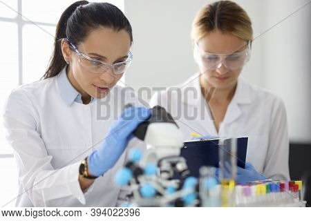 Two Researchers In Laboratory Are Doing Research. Design Research Work In Chemistry And Medicine Con