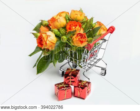 Gifts, Flowers In The Shopping Cart. Buyer's Basket. Full Shopping Cart. The Concept Of Gifts And Sh