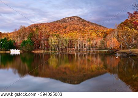 Mt. Yonah, Georgia, USA from Chambers Lake in autumn at dusk.