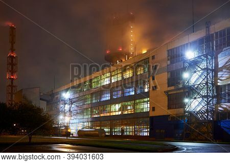 Petrochemical Plant In Night. Urea Granulation Tower Fertilizer Granulator Prilling High-tower Compl
