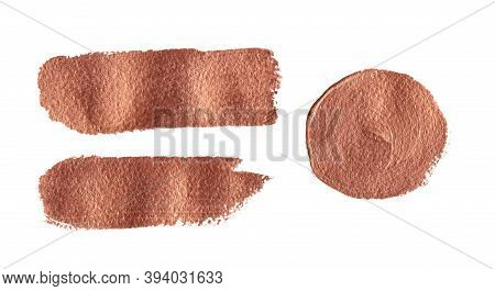 A Set Of Textured Bronze Paint Strokes And A Circle On White Background