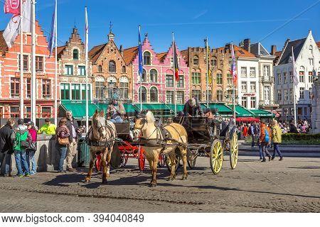 Bruges, Belgium - April 10, 2016: Horse Carriage On Market Square In Popular Belgian Destination Bru